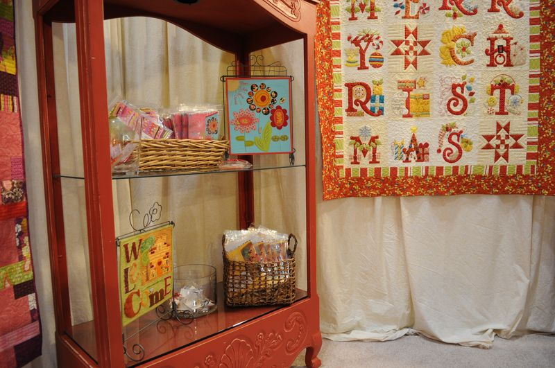 2011 Booth - red cabinet w/mini quilts