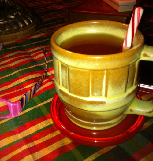 Mug of tea w/peppermint stick